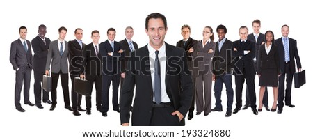 Confident business people standing against white background - stock photo