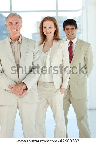 Confident business people standing together in a business building