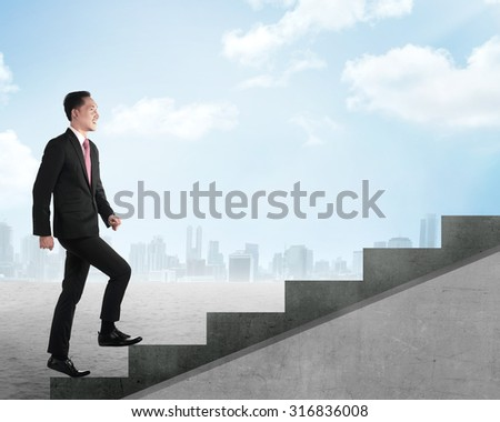 Confident business person walking upstairs. Business career concept