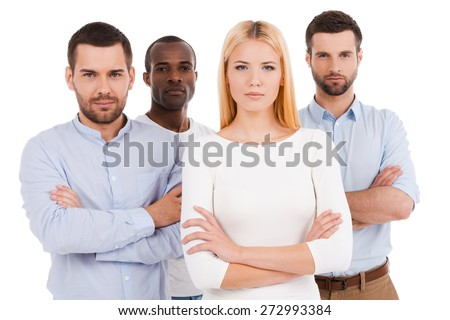 Confident business team. Four young and confident people in smart casual wear looking at camera while standing against white background - stock photo
