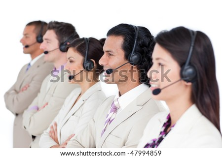 Confident business team lining up with headset on against a white background - stock photo