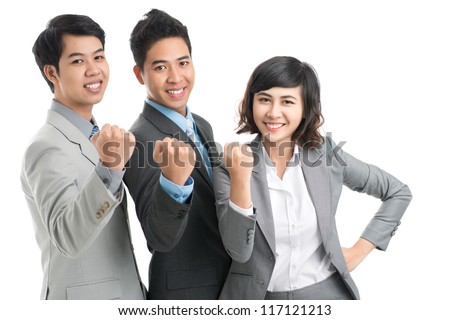 Confident business team showing fist at camera
