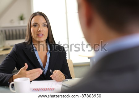 Confident business woman in office meeting