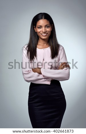 Confident business woman portrait smiling at camera