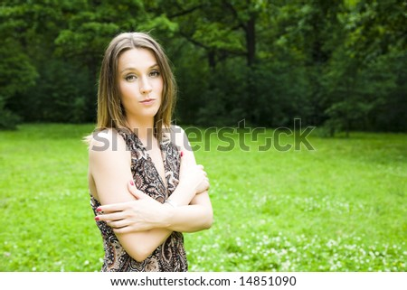 Confident business woman relaxing in the park