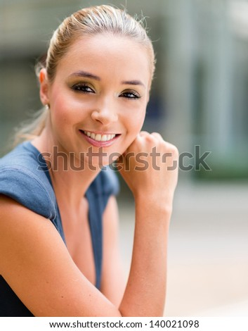 Confident business woman smiling and looking very happy
