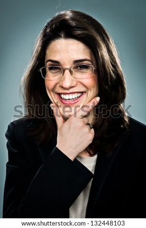 Confident Business Woman Smiling Over a Grey Background
