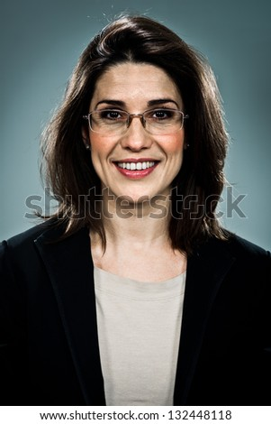Confident Business Woman Smiling Over a Grey Background - stock photo