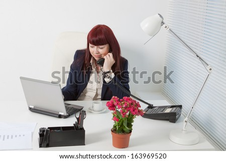 Confident business woman speaking by phone - stock photo