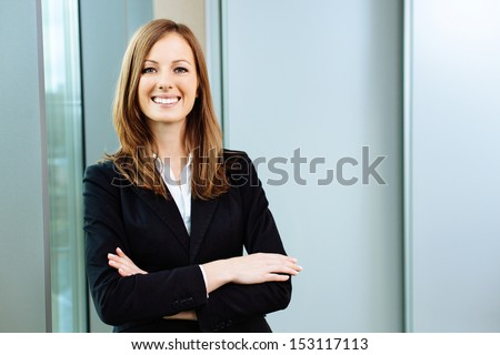 Confident business woman stands in the office