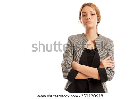 Confident business woman with arms crosses and head up posing on white background - stock photo