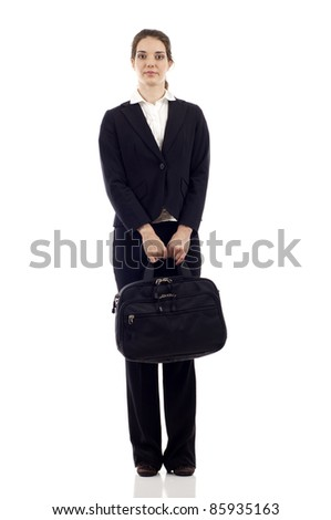 Confident business woman with briefcase standing isolated over white background - stock photo