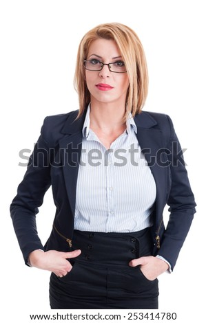 Confident business woman with hands in her skirt pockets - stock photo