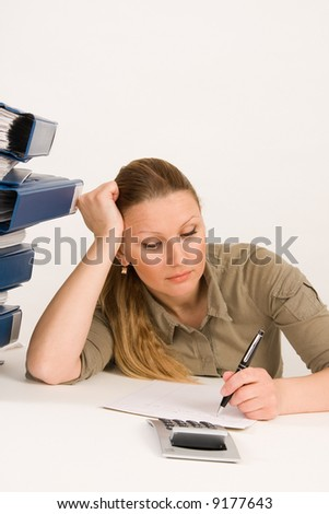 Confident business woman working with documents