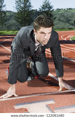 Confident businessman are about to run in a race - stock photo