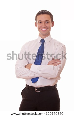 confident businessman arms folded looking at camera - stock photo