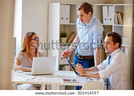 Confident businessman explaining his viewpoint to secretary