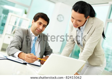 Confident businessman explaining something to colleague at meeting - stock photo