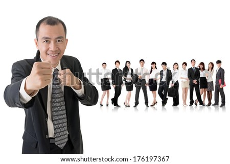 Confident businessman fighting and standing in front of his team on studio white background.