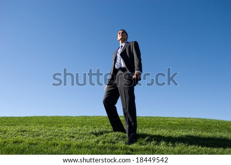 Confident businessman in dark suit