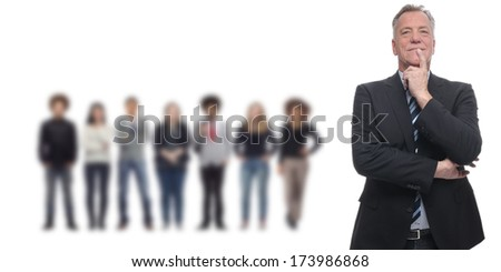 Confident businessman in front of diverse business team - stock photo