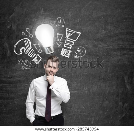 Confident businessman is thinking about optimisation measures for business. Turned lightbulb and question and exclamation marks - stock photo