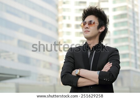 Confident businessman look and think in the outside office building. - stock photo