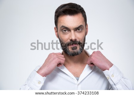 Confident businessman looking at camera isolated on a white background - stock photo