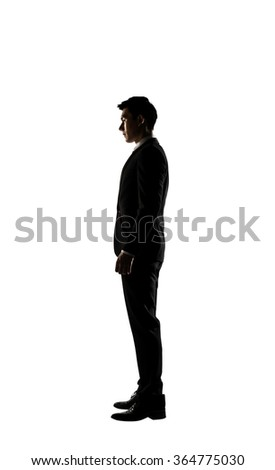 Confident businessman of Asian, silhouette portrait isolated - stock photo