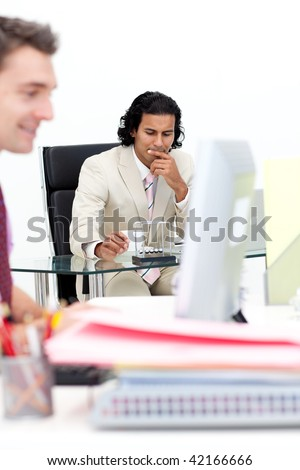 Confident businessman playing with kinetic balls at work. Business concept. - stock photo