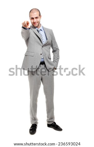 Confident businessman pointing at you - stock photo