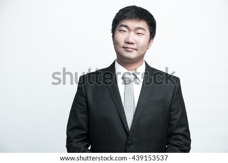 Confident businessman posing happy isolated