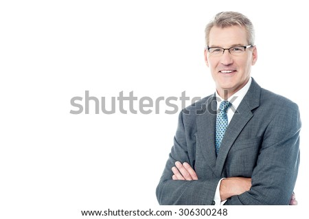 Confident businessman posing with folded arms - stock photo