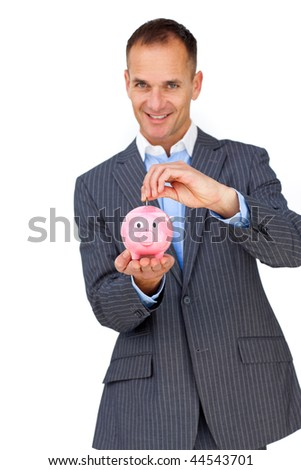 Confident businessman saving money in a piggybank against a white background - stock photo
