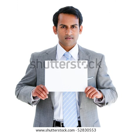 Confident businessman showing a note in the office - stock photo