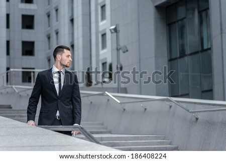 Confident businessman .  Side view of  young men in formalwear.