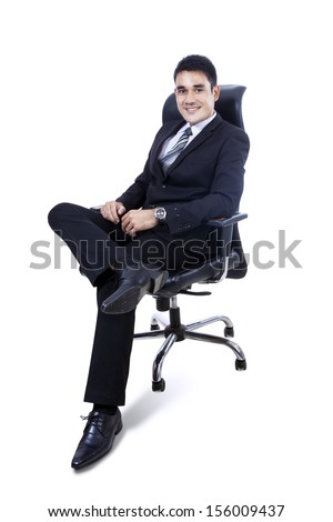 Confident businessman sitting on chair isolated over white