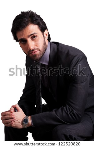 confident businessman sitting on office chair - stock photo