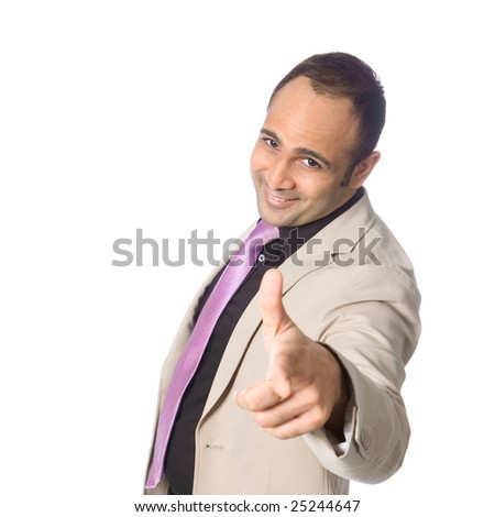 Confident businessman smiling and pointing towards viewer.