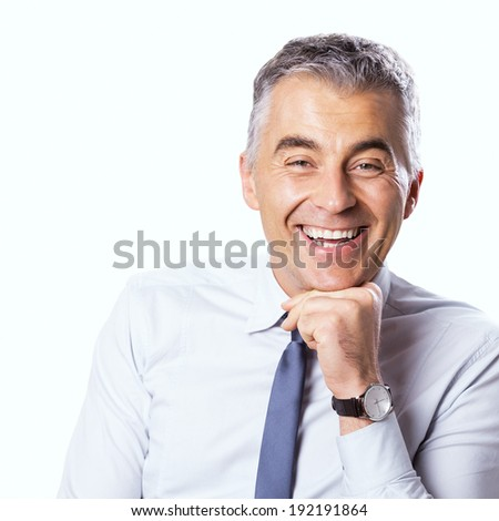 Confident businessman smiling with hand on chin and looking at camera on white background. - stock photo