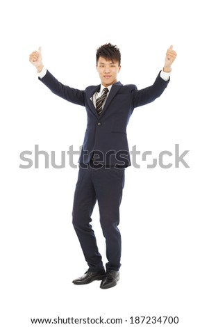 confident businessman standing and thumb up   - stock photo