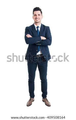Confident businessman standing with arms crossed and smiling isolated on white background - stock photo