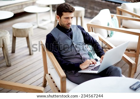 Confident businessman typing on laptop computer keyboard working, caucasian business man in suit sitting at work break in cafe with computer, businesspeople using technology, success concept - stock photo