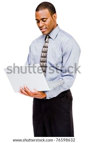 Confident businessman using a laptop and posing isolated over white