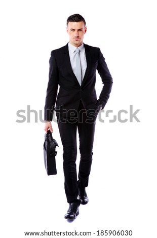 Confident businessman walking with laptop bag isolated on a white background - stock photo