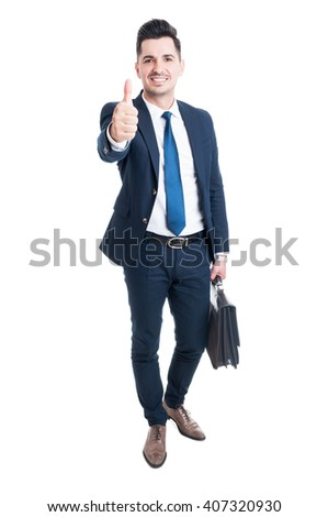 Confident businessman wearing blue suit and briefcase showing like standing isolated on white background - stock photo