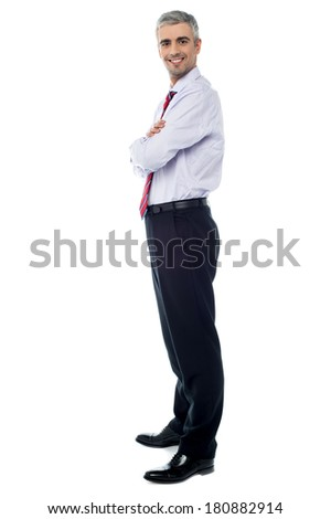 Confident businessman with arms crossed - stock photo