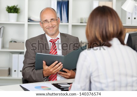 confident businessman with female candidate in interview - stock photo