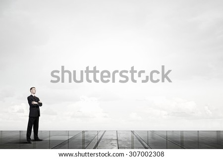 Confident businessman with his arms crossed on chest - stock photo