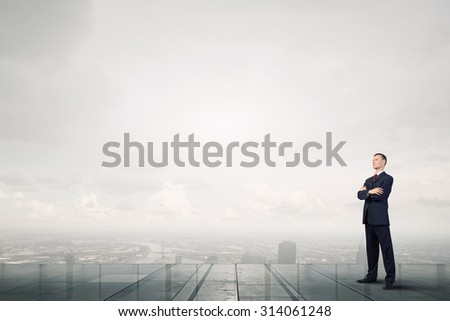 Confident businessman with his arms crossed on chest